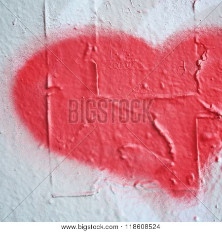 Pink Heart Shaped Symbol On The Concrete Wall.