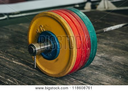 barbell on a wooden floor