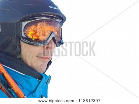 Skier man in the blue skiing jacket, helmet and glasses isolated on white background