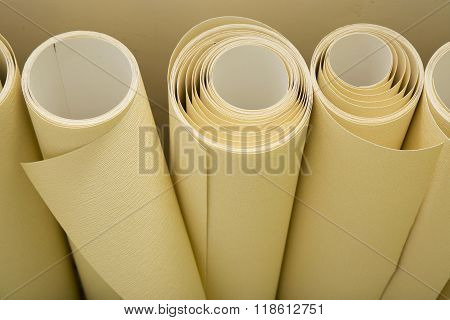 Rolls of wallpaper ready for applying
