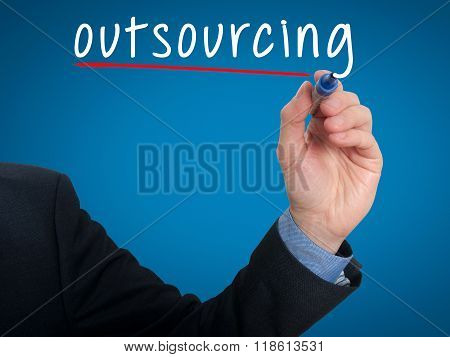 Businessman Hand Writing Outsourcing Isolated On Blue Background
