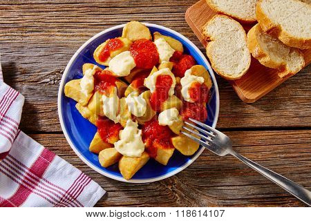 Tapas Patatas Bravas potatoes fries with tomato and mayonaise from Spain