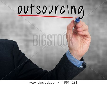 Businessman Hand Writing Outsourcing Isolated On Grey Background