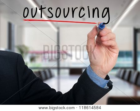 Businessman Hand Writing Outsourcing Isolated On Office Background