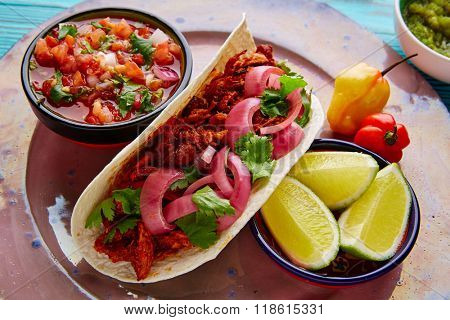 Cochinita Pibil Mexican food with pico de gallo lemon and chili