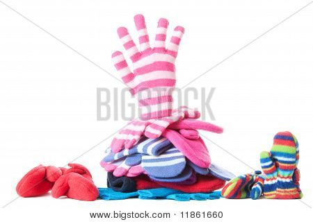 Stack Of Winter Gloves And Mittens With Hand Symbol | Isolated