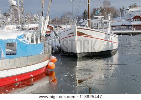 Fishing Boats Boat In The Small Harbor During Winter Time