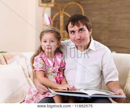 young family at home with a daughter