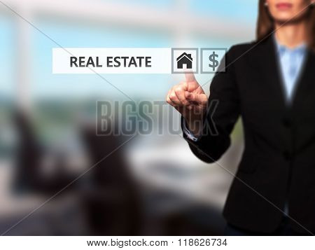Businesswoman Pressing Real Estate Button On Virtual Screens