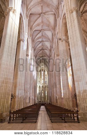Batalha, Portugal - March, 2015: Batalha Monastery. Nave, Aisles and entrance of the Church. Gothic and Manueline masterpiece. Portugal. UNESCO World Heritage Site.