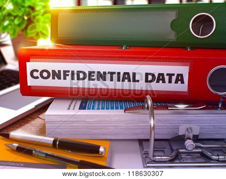 Confidential Data on Red Office Folder. Toned Image.