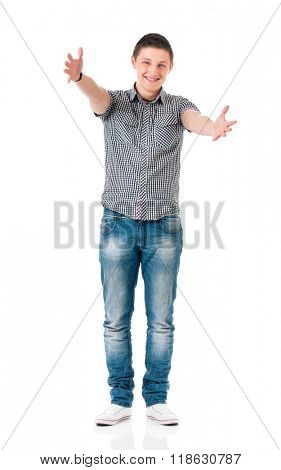 Full length portrait of smiling young man greets with his hands, isolated on white background