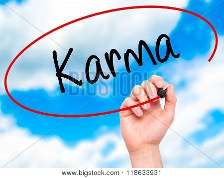 Man Hand Writing Karma  With Black Marker On Visual Screen