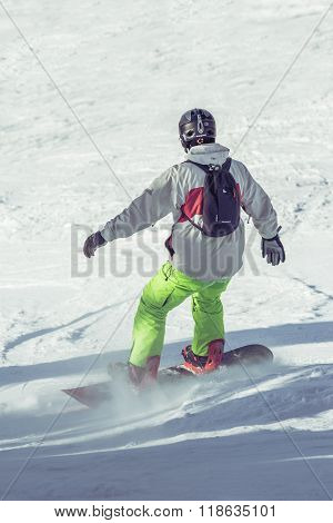 Young Snowboarder Sliding On Ski Slope