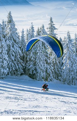 Paragliding Instructor Taking Off The Ski Slope