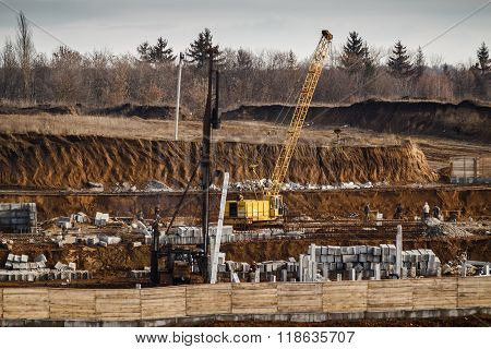 Foundation Ditch With Crane And Construction Machinery At Construction Site