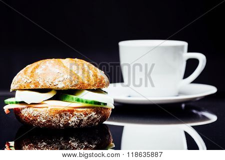 Wholemeal Breakfast Sandwich And Cup Of Coffee
