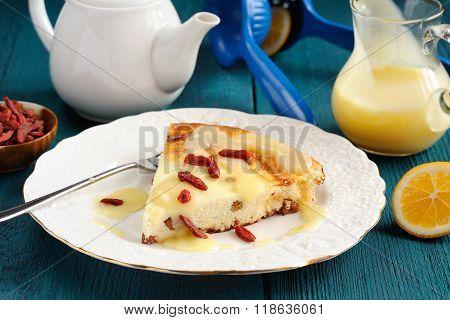 Homemade Cheesecake With Raisins, Lemon Curd And Goji Berries