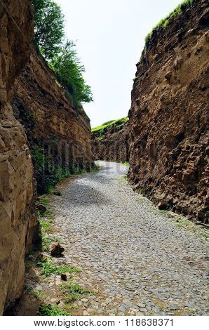 Cobblestone Road Between Ravine