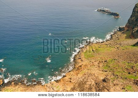 Volcanic Islet By Coastline