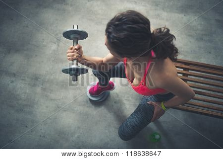 Seen From Above Fitness Woman Lifting Dumbbell