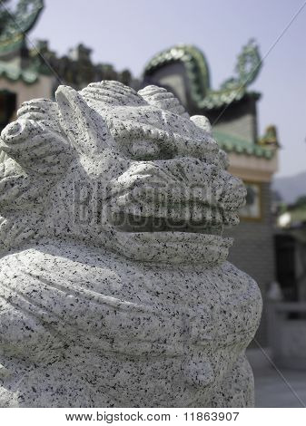 stone lion in front of Chinese temple
