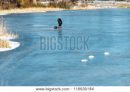 Fisherman On The Pond