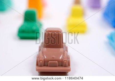 Colorful plastic toy cars.