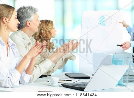 Cropped image of business people clapping hands during meeting