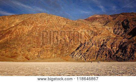 Tourists Walk On The Salt Flats At Badwater Basin In Death Valley