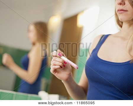 Young Woman With Pregnancy Test Kit