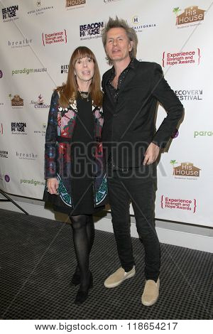 Mackenzie Phillips and John Taylor arrive at the