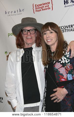 Bob Forrest and Mackenzie Phillips arrive at the