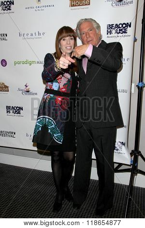 Mackenzie Phillips and Leonard Lee Buschel arrive at the