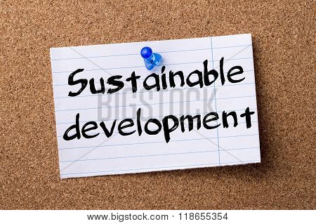Sustainable Development - Teared Note Paper Pinned On Bulletin Board