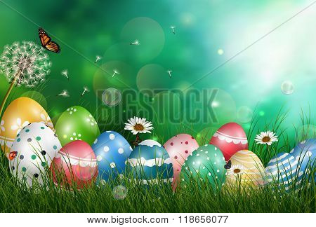 Easter eggs in meadow with sun rays on green background