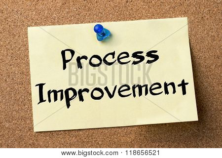 Process Improvement - Adhesive Label Pinned On Bulletin Board