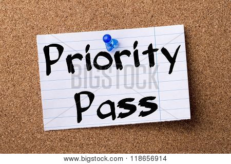 Priority Pass - Teared Note Paper Pinned On Bulletin Board