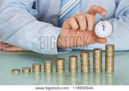 Businessman Holding Stopwatch