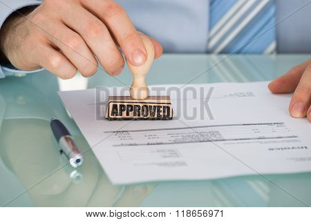 Person's Hand Stamping On Document