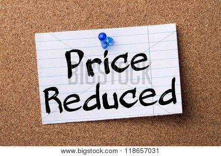 Price Reduced - Teared Note Paper Pinned On Bulletin Board