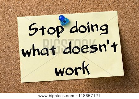 Stop Doing What Doesn't Work - Adhesive Label Pinned On Bulletin Board