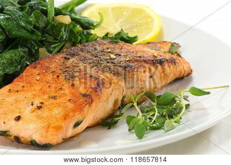 Grilled Salmon With Thyme, Lemon And Spinach On White, Vegetarian Low Carb Dish, Close Up