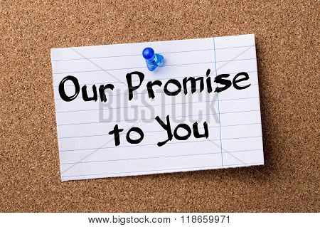 Our Promise To You - Teared Note Paper Pinned On Bulletin Board