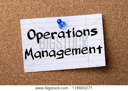 Operations Management - Teared Note Paper Pinned On Bulletin Board