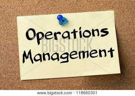 Operations Management - Adhesive Label Pinned On Bulletin Board