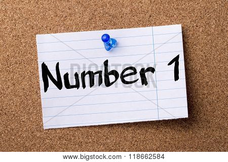 Number 1 - Teared Note Paper Pinned On Bulletin Board