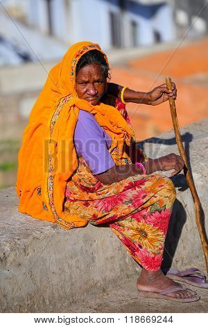 Jaipur, India - November 14: Unidentified Woman Sits On A Stone Wall On November 14, 2014  In Jaipur