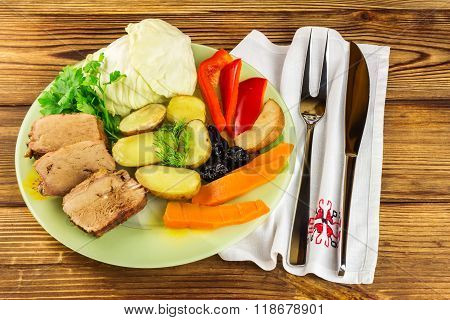 Healthy Food, Sliced Pork Meat With Stewed Various Vegetables In Plate, Knife And Fork On Napkin, Wo