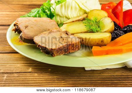 Healthy Food, Sliced Pork Meat With Stewed Various Vegetables In Plate, On Wooden Background, Close-